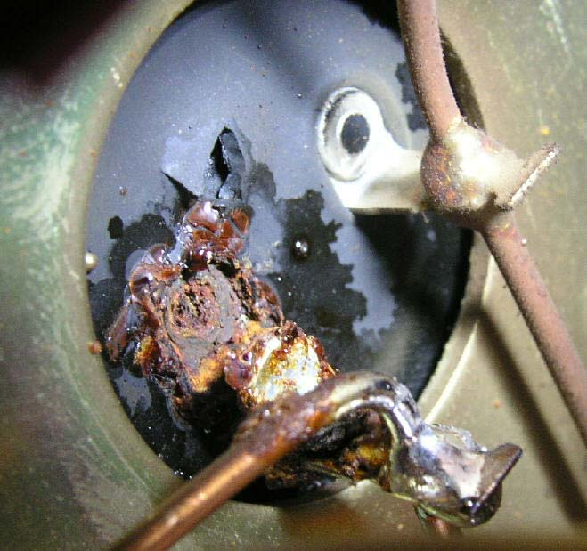An original electrolytic capacitor from the Musical Fidelity A370 that has vented